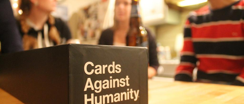 Playing Cards Against Humanity - Photo Courtesy of Connle Ma of flickr