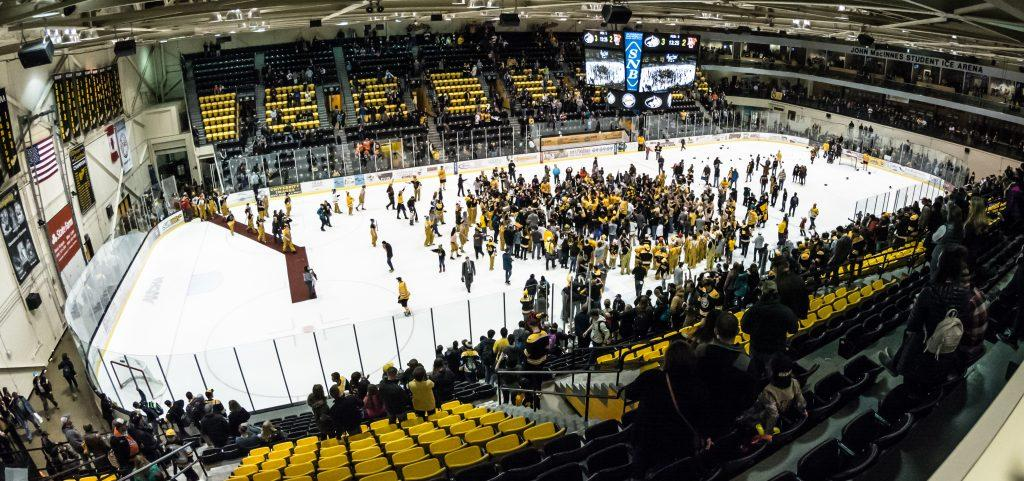 Fans ran onto the ice to celebrate the Huskies' win.      - Photo by Horatio Babcock