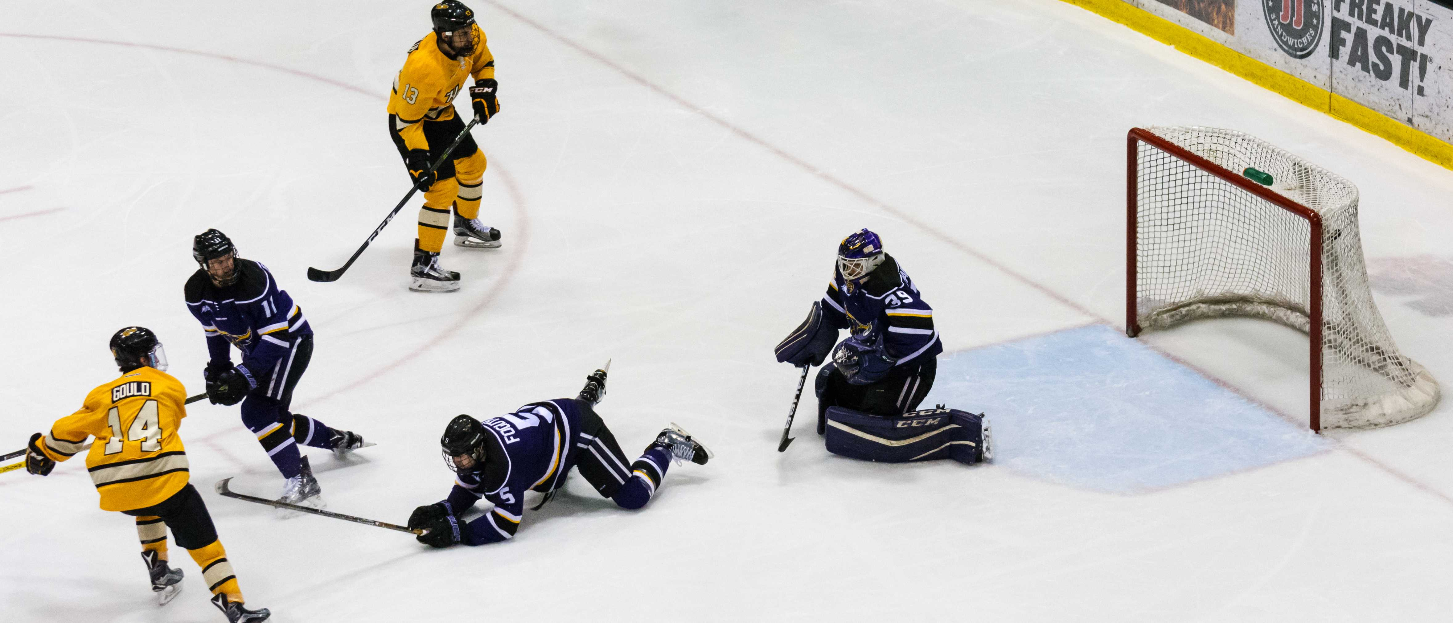 Freshman forward Gavin Gould, far left, scoring the first goal in his hat trick.                      - Photo by Horatio Babcock