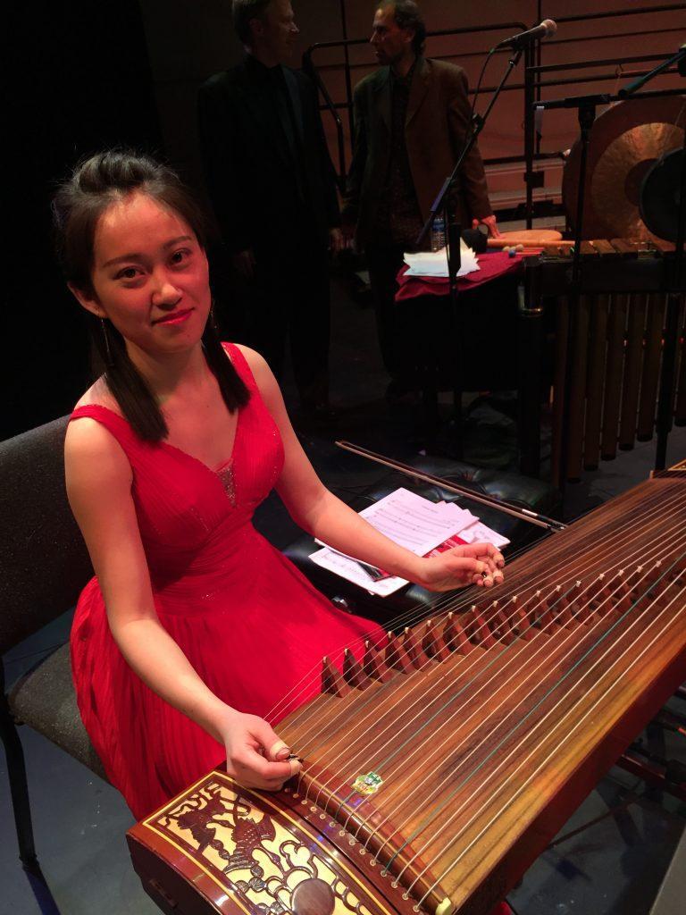 Yu Chen Wang poses with her instrument the zheng. - Photo by Aemili Lipzinski