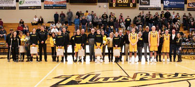 The Michigan Tech basketball seniors pose between the men's and women's games Saturday.