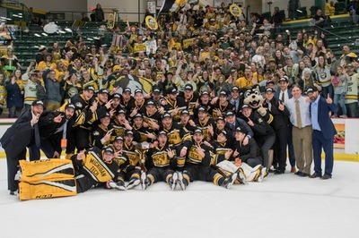Tech hockey team celebrates with the Jeff Sauer Trophy after winning the WCHA tournament, 2-0 over Northern.