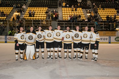 The hockey seniors pose after their 3-2 win over Northern Michigan Saturday.