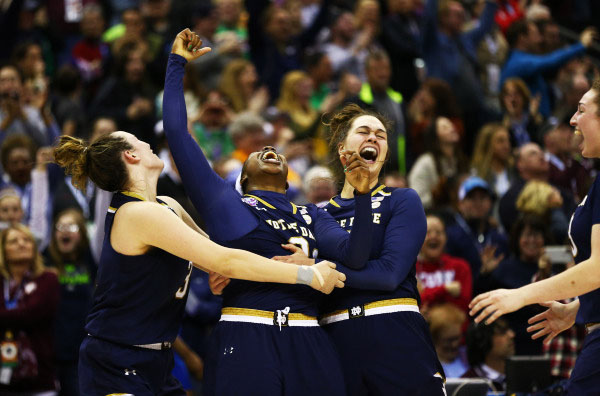 Arike Ogunbowale Marina Mabrey and Kathryn Westbeld celebrate after winning the national championship.