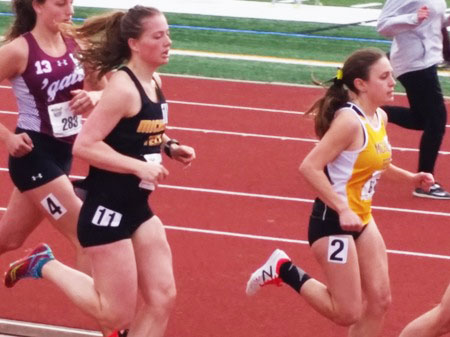 A couple of runners cross the finish line for Michigan Tech.