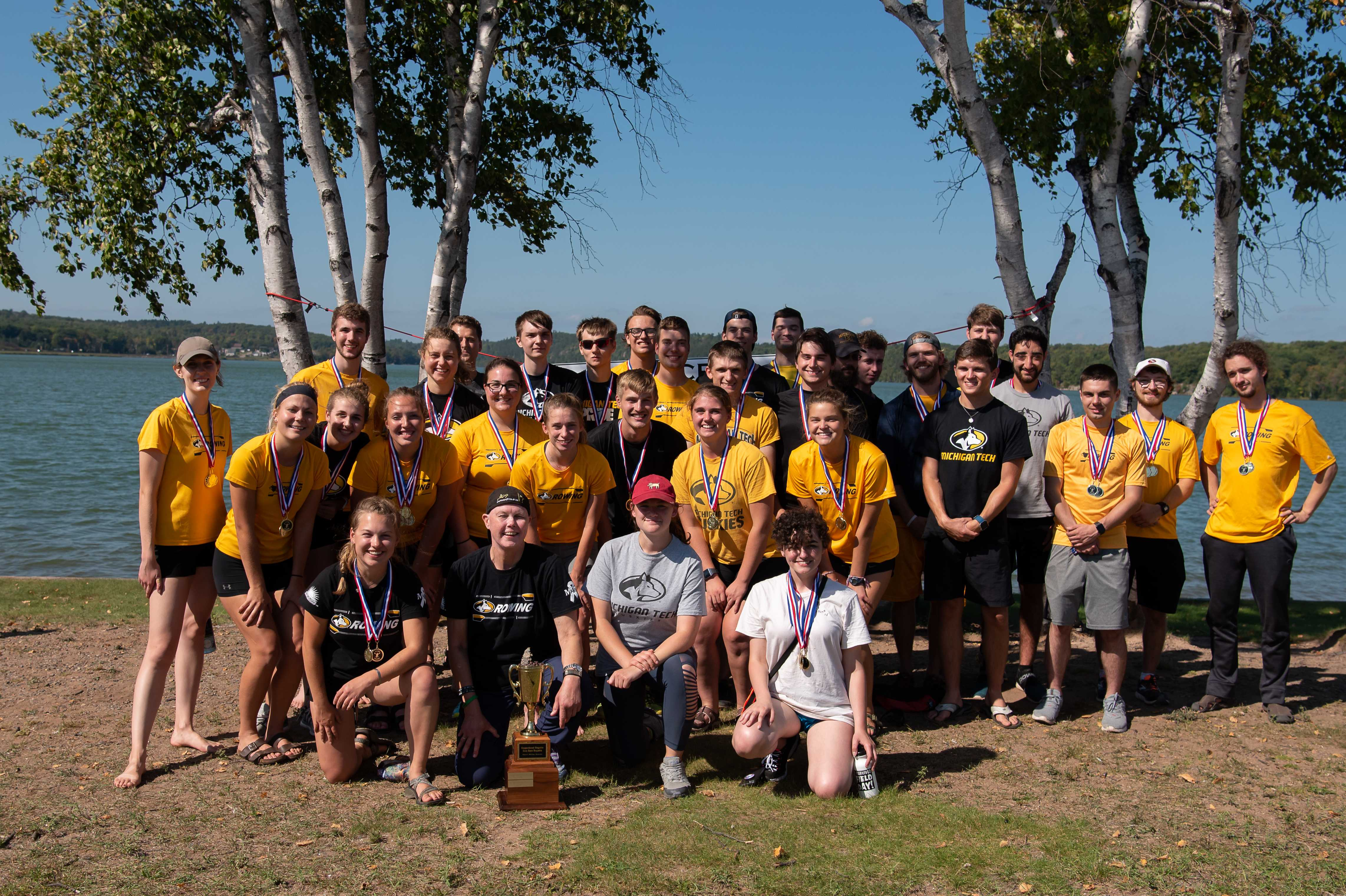 The Michigan Tech Rowing Club and all of the participants at the Iron Oars Regatta in Marquette with their trophy.