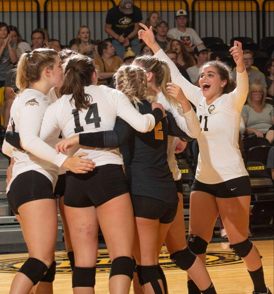 Players+from+the+Michigan+Tech+volleyball+team+celebrate+their+victory.