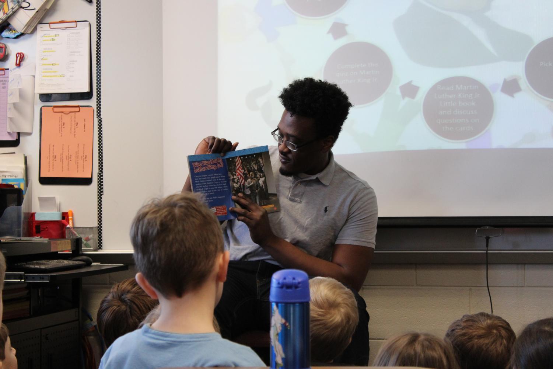 Stewart Liburd reads to Emelia Johnson's third grade class.