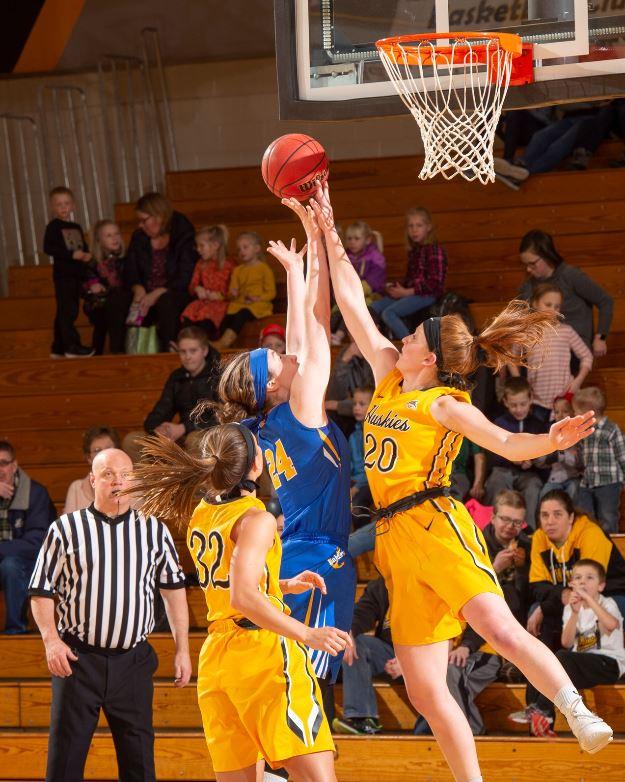 Hannah Hobson (20) blocks a shot by the Lake Superior State.