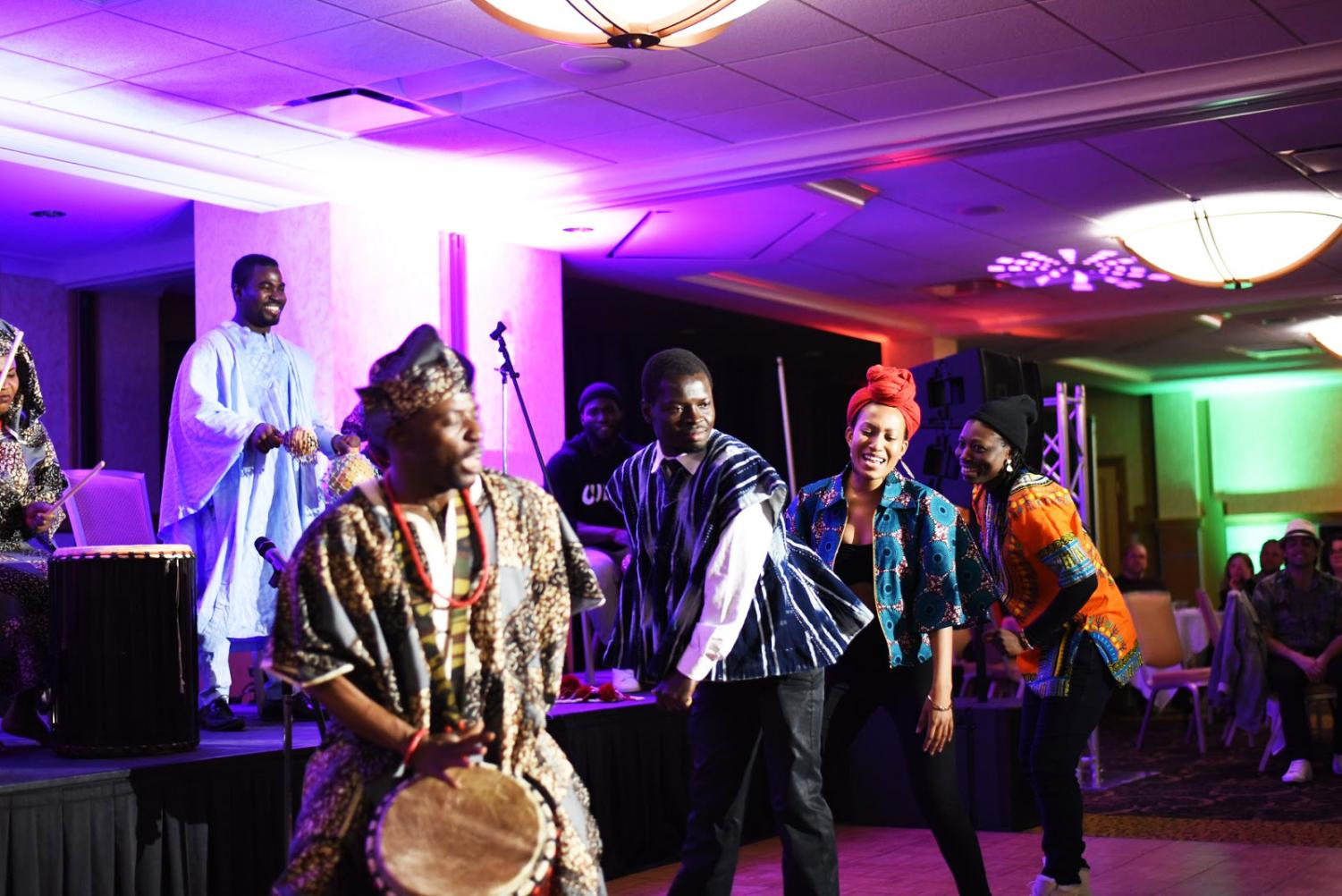 Some students and performers dancing at 2018 African Night.
