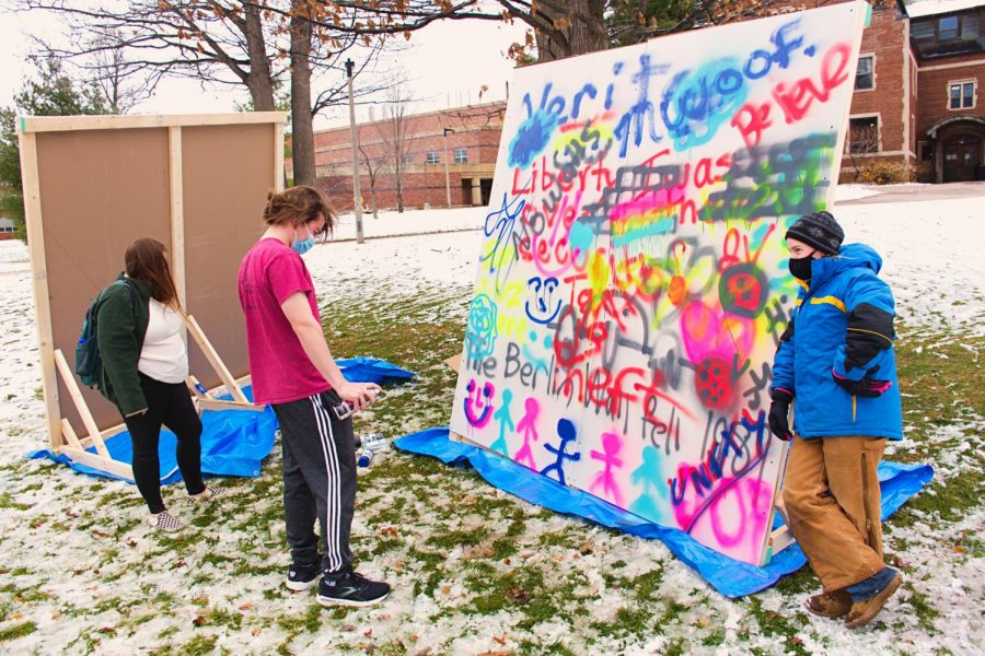 Michigan Tech students are shown here participating in the interactive Berlin Wall memorial hosted on Nov. 11 by Young Americans for Freedom.