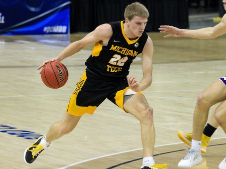 Photo from Michigan Tech Athletics shows no. 22, Owen White